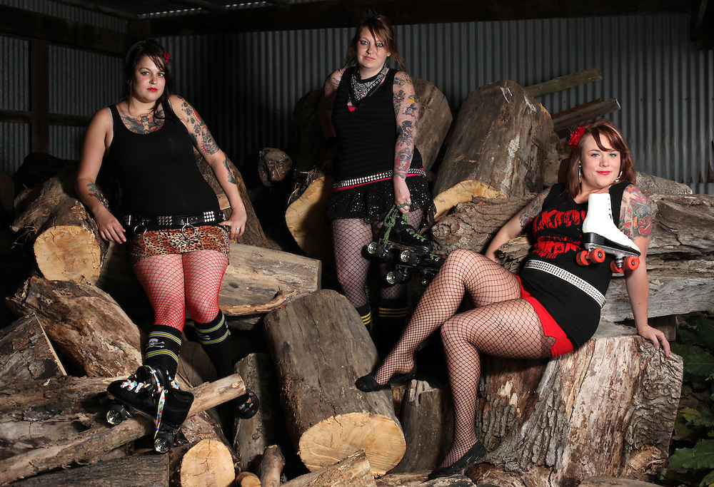 Ashley Johnson, Viki Beall, Brittney Kirtley. Cornfed Derby Dames.       .(Chris Bergin/The Star Press)