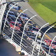 The pack is seen as they storm down the front stretch during the 58th Annual NASCAR Daytona 500 auto race at Daytona International Speedway on Sunday, February 21, 2016 in Daytona Beach, Florida.  (Alex Menendez via AP)
