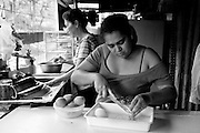 Laura helps her mother prepare lunch. Even though Laura and her children no longer live with her mother, they are just up the hill and often visit. Nicaraguan families have a strong sense of family and community and Aura's family is no different. They are in constant communication.