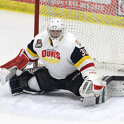 WELLINGTON, ON - FEBRUARY 9: Logan Bateman #30 of the Wellington Dukes stretches prior to the Strat of the third period on February 9, 2019 at Wellington and District Community Centre in Wellington, Ontario, Canada.<br /> (Photo by Tim Bates / OJHL Images)