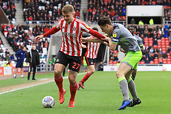 March 16, 2019 - Sunderland, Tyne and Wear, United Kingdom - Sunderland's Max Power contests for the ball with Walsall's George Dobson during the Sky Bet League 1 match between Sunderland and Walsall at the Stadium Of Light, Sunderland on Saturday 16th March 2019. (Credit: Steven Hadlow | MI News) (Credit Image: © Mi News/NurPhoto via ZUMA Press)