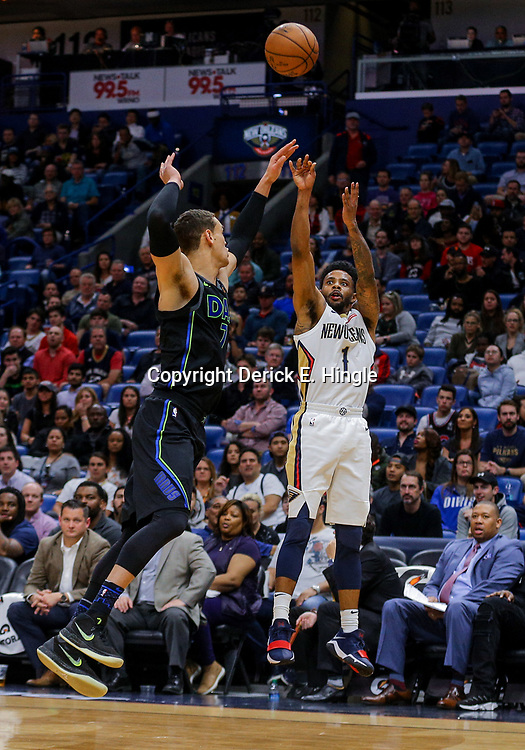 Mar 20, 2018; New Orleans, LA, USA; New Orleans Pelicans guard Larry Drew II (1) shoots over Dallas Mavericks center Dwight Powell (7) during the second half at the Smoothie King Center. Pelicans defeated the Mavericks 115-105. Mandatory Credit: Derick E. Hingle-USA TODAY Sports