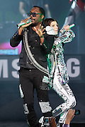 NEW YORK - MARCH 10:  Singers Will.i.am and Fergie of the Black Eyed Peas perform live at the Samsung Times Square Concert with THE BLACK EYED PEAS at Times Square on March 10, 2010 in New York City.  (Photo by Joe Kohen/Getty Images for Samsung)