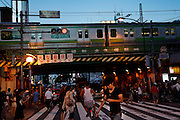 Tokyo, September 18 2011 - In front of the exit of Shinokubo's train station. Korean mania reached Tokyo's Korean neighborhood near Shinokubo station. For a long time Japanese ladies in their 50ies have been interested in Korean televised dramas. Recently the success of K-Pop (Korean popular music) in Japan has brought a younger population in the neighborhood.