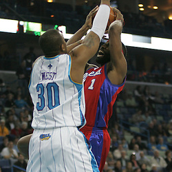 Jan 13, 2010; New Orleans, LA, USA; Los Angeles Clippers guard Baron Davis (1) shoots over New Orleans Hornets forward David West (30) during the first quarter at the New Orleans Arena. Mandatory Credit: Derick E. Hingle-US PRESSWIRE