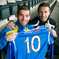 St Johnstone's Peter MacDonald who has signed a new contract which will see him reach 10 years at McDiarmid Park, he is pictured with manager Derek McInnes....30.12.10<br /> see story by Gordon Bannerman Tel: 07729 865788<br /> Picture by Graeme Hart.<br /> Copyright Perthshire Picture Agency<br /> Tel: 01738 623350  Mobile: 07990 594431