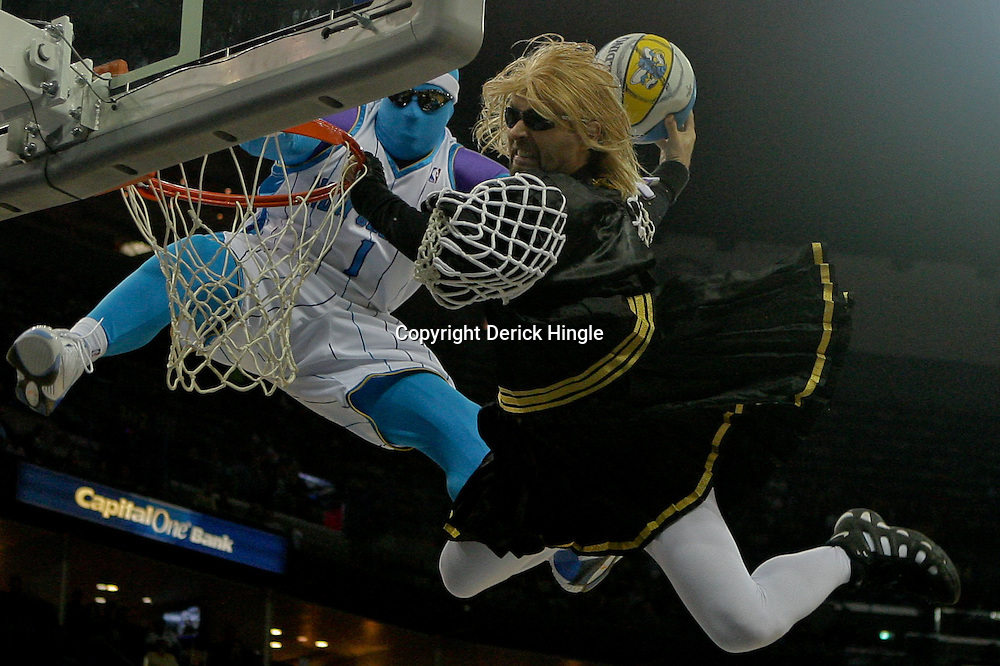 Dec 08, 2009; New Orleans, LA, USA; New Orleans Hornets mascot Super Hugo blocks a dunk by the Sacramento Kings mascot during a break in the action in the second half at the New Orleans Arena. The Hornets defeated the Kings 96-94. Mandatory Credit: Derick E. Hingle-US PRESSWIRE