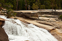 Rushing river landscape pouring over sandstone rocks in pine forest, Yosemite. Landscape and nature photography wall art for sale.