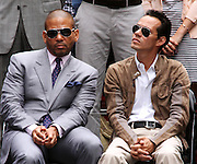 """Benny Medina and Marc Anthony appear with Jennifer Lopez to unveil her """"Be Extraordinary"""" Poster in Times Square New York City on June 10, 2010."""