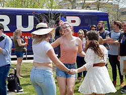 Trump-Supporters and anti-Trump protestors face each other outside an April 25, 2016 rally of the Republican candidate, held at the campus of West Chester University in West Chester, Pennsylvania a day ahead of the Pennsylvania Primary.