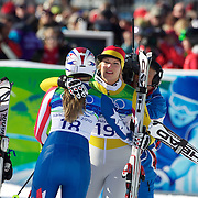 Winter Olympics, Vancouver, 2010.Gold medal winner Maria Riesch, Germany, (left) with Lindsey Vonn, USA, who crashed  in the Ladies Super Combined during competition at Whistler Creekside, Whistler, during the Vancouver Winter Olympics. 18th February 2010. Photo Tim Clayton