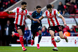 Jayden Mitchell-Lawson of Bristol Rovers takes on Luke O'Nien of Sunderland and Jordan Willis of Sunderland - Mandatory by-line: Robbie Stephenson/JMP - 22/02/2020 - FOOTBALL - Stadium of Light - Sunderland, England - Sunderland v Bristol Rovers - Sky Bet League One