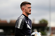 AFC Wimbledon goalkeeper Joe McDonnell (24) warming up during the EFL Cup match between AFC Wimbledon and Brentford at the Cherry Red Records Stadium, Kingston, England on 8 August 2017. Photo by Matthew Redman.