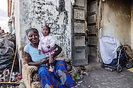Boreano, Basilicata, Italia, 13/09/2013 <br /> Una donna africana con il figlio in braccio davanti ad un casolare di Boreano. Pi&ugrave; volte le associazioni locali hanno denunciato anche un giro di prostituzione nei casolari di Boreano. <br /> <br /> Boreano, Basilicata, Italy, 13/09/2013 <br /> An African woman with her son in front of a farmhouse in Boreano. Several time local associations reported a prostitution network in Boreano farmhouses.