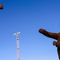 Eldon Kee tosses a football during a game of catch at Angelo DiPaolo stadium in Gallup Thursday.