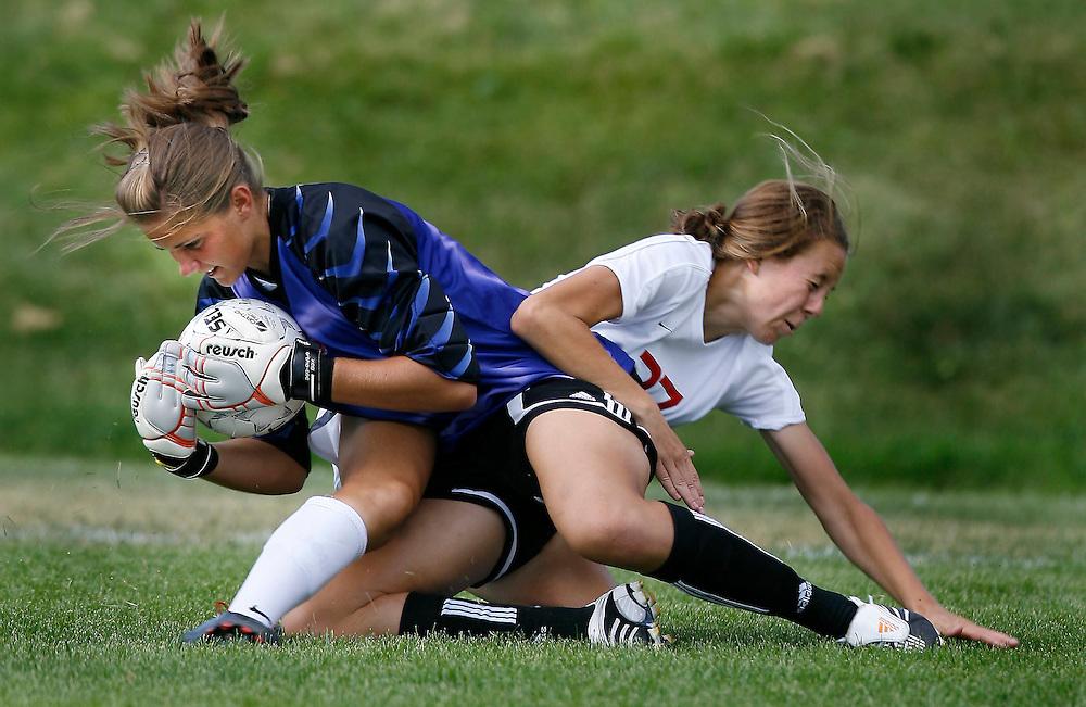 East High's Saralynn Drury crashes into Highland's goalie Erica Owens in girls soccer at East High School in Salt Lake City, Utah Thursday, August 30, 2007.  August Miller/ Deseret Morning News