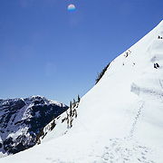 Andy Mahre gets ready to drop off of a cornice line in Glacier National Park.