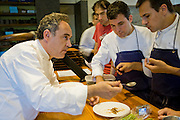 Ferran Adrià, chef of El Bulli restaurant near Rosas on the Costa Brava in Northern Spain, on the Mediterranean, tastes sauces with his chefs. (Ferran Adrià is featured in the book What I Eat: Around the World in 80 Diets.)