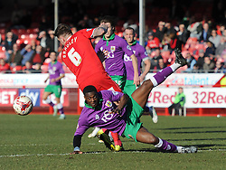 Bristol City's Kieran Agard is challenged by Crawley's Sonny Bradley - Photo mandatory by-line: Dougie Allward/JMP - Mobile: 07966 386802 - 07/03/2015 - SPORT - Football - Crawley - Broadfield Stadium - Crawley Town v Bristol City - Sky Bet League One