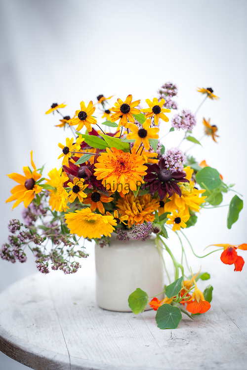 Flower Arrangement with Calendula officinalis 'Princess' mixed - pot marigold, Rudbeckia hirta 'Goldilocks', 'Prarie Glow' and 'Cherry Brandy' - black-eyed Susan, Origanum vulgare - wild marjoram and Tropaeolum majus - nasturtium