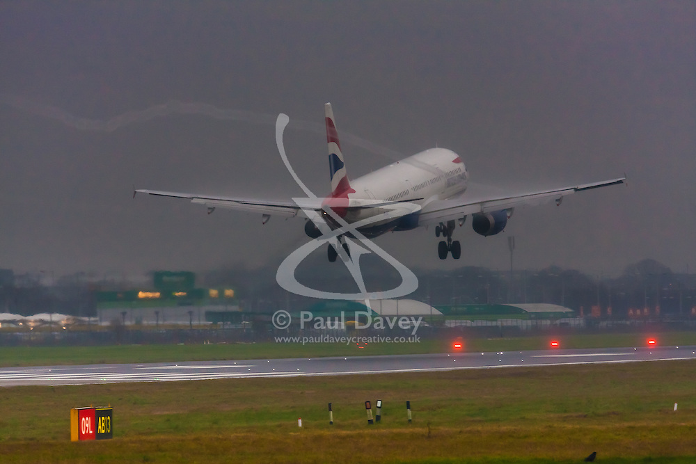 """January 3rd 2015, Heathrow Airport, London. Low cloud and rain provide ideal conditions to observe wake vortexes and """"fluffing"""" as moisture condenses over the wings of landing aircraft. With the runway visible only at the last minute, several planes had to perform a """"go-round"""", abandoning their first attempts to land. PICTURED: A wake vortex spirals off the wingtip of a British Airways Airbus A321 as it lands on Heathrow's Runway 27 Left."""