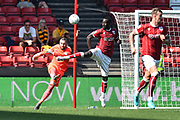 Famara Diedhiou (9) of Bristol City leaps in front of goalkeeper Allan McGregor (1) of Hull City who is clearing the ball up field during the EFL Sky Bet Championship match between Bristol City and Hull City at Ashton Gate, Bristol, England on 21 April 2018. Picture by Graham Hunt.