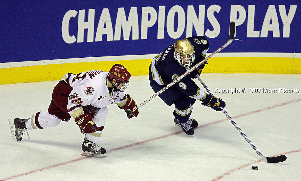 SHOT 4/12/08 7:41:27 PM - Boston College's Dan Bertram (#22) tries to defend against Notre Dame's Ryan Thang (#9) during the third period of their NCAA Frozen Four championship game at the Pepsi Center in Denver, Co. Boston College won the game 4-1 to win the national championship..(Photo by Marc Piscotty / © 2008)