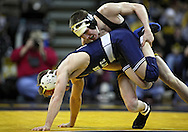January 29, 2010: Iowa's Matt McDonough controls Penn State's Brad Pataky in the 125-pound bout at Carver-Hawkeye Arena in Iowa City, Iowa on January 29, 2010. McDonough won the match 7-2 and Iowa defeated Penn State 29-6.