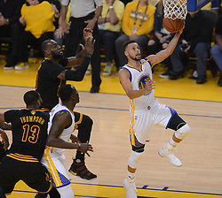 June 12, 2017 - Oakland, CA, USA - The Golden State Warriors' Stephen Curry (30) drives past the Cleveland Cavaliers' LeBron James (23) in the first quarter of Game 5 of the NBA Finals at Oracle Arena in Oakland, Calif., on Monday, June 12, 2017. (Credit Image: © Dan Honda/TNS via ZUMA Wire)