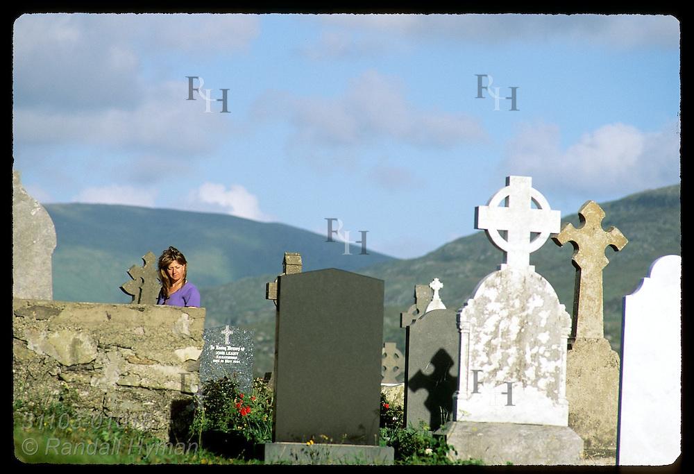 American tourist, Colette Ogle, walks through Kilcatherine cemetery on the Beara Peninsula, Ireland.