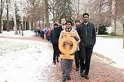 Jorden Tyner, Derrick Holifield, Brandon Chestnut and Jerry Mobley of the Phi Chapter of the Alpha Phi Alpha Fraternity lead Ohio University students and faculty in a silent march on Martin Luther King Day. (Photo by Olivia Wallace)