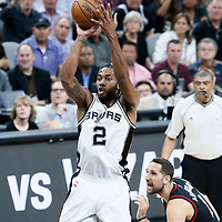 03 May 2017: San Antonio Spurs forward Kawhi Leonard (2) takes a jump shot past Houston Rockets forward Ryan Anderson (3) during the San Antonio Spurs 121-96 victory over the Houston Rockets, in game 2 of the Western Conference Semi Finals, at the AT&T Center, San Antonio, Texas, USA.