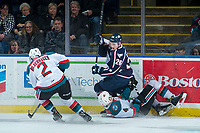KELOWNA, CANADA - JANUARY 3: Riley Sawchuk #26 of the Tri-City Americans checks Gordie Ballhorn #4 as James Hilsendager #2 of the Kelowna Rockets steals the puck from the play on January 3, 2017 at Prospera Place in Kelowna, British Columbia, Canada.  (Photo by Marissa Baecker/Shoot the Breeze)  *** Local Caption ***