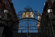 Ornate iron gates of the original New Scotland Yard, headquarters of London's Metropolitan Police at 4 Whitehall Place. The buildings are in banded red brick and white portland stone on a granite base in the Victorian Gothic style, and are located upon Victoria Embankment next-door to Portcullis House. The North Building is Grade I listed. It was designed in 1887.