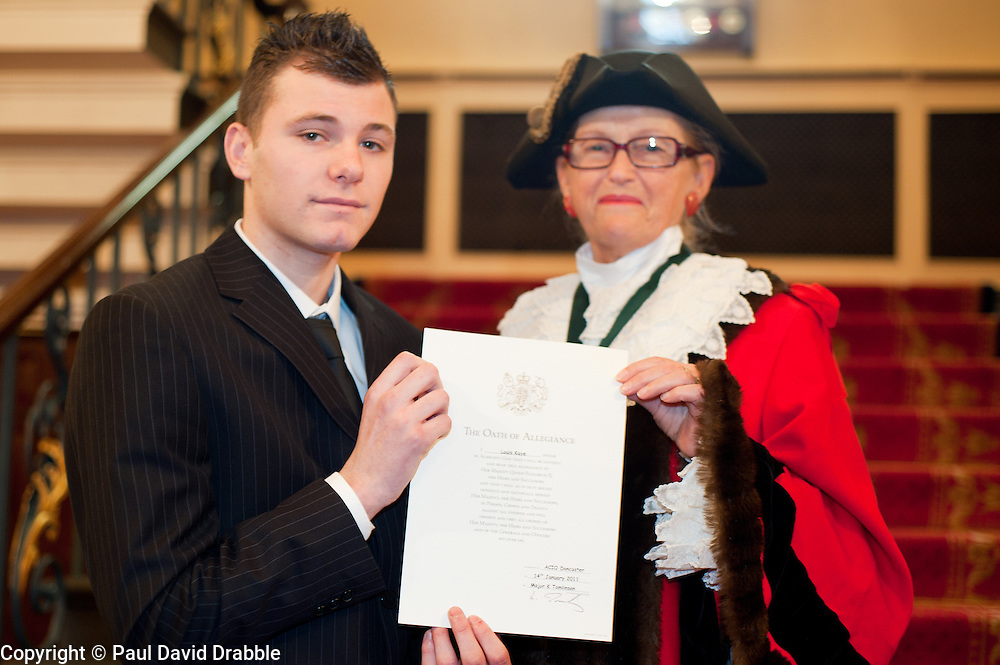 British Army Enlistments Oath of Allegiance held at the Mansion House Doncaster South Yorkshire. recruit Louis Kaye with Deputy Mayor of Doncaster, Councillor Patricia Schofield  .14 January 2010.Images © Paul David Drabble