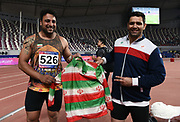 Ehsan Hadadi (left) and Behnam Shiri (IRN) pose after placing first and second in the discus 199-9 during the Asian Athletics Championships in Doha, Qatar, Saturday, April,21, 2019. (Jiro Mochizuki/Image of Sport)