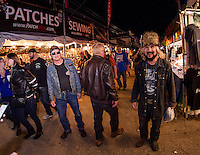 "Bruce Taylor (on right) the ""Medicine Man"" walks through the Roadhouse vendors Friday evening.  Taylor has been coming to Bike Week since 1960. His first motorcycle was a 1947 Knucklehead Harley Davidson.   (Karen Bobotas/for the Laconia Daily Sun)"