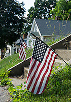 American flags were placed on the front lawn of each home along Walker Street and Cottonwood Ave. in Laconia over the July 4th Holiday weekend.  (Karen Bobotas/for the Laconia Daily Sun)