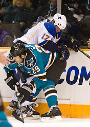 January 6, 2010; San Jose, CA, USA; San Jose Sharks left wing Ryane Clowe (29) checks St. Louis Blues center Derek Armstrong (17) into the boards during the first period at HP Pavilion. San Jose defeated St. Louis 2-1 in overtime. Mandatory Credit: Jason O. Watson / US PRESSWIRE