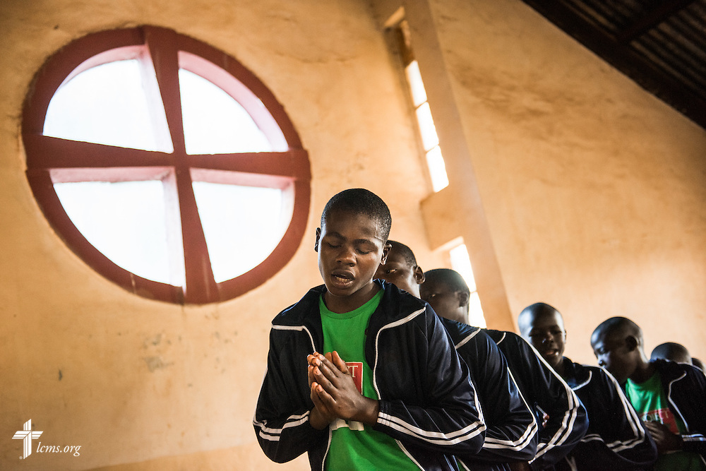 Young men of the Othoro ELCK (Evangelical Lutheran Church in Kenya) Project 24 program sing during worship at the Othoro Lutheran congregation adjacent to the boarding facility on Sunday, Oct. 18, 2015, in Kisumu, Kenya. LCMS Communications/Erik M. Lunsford