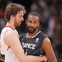 15 July 2012: Ronny Turiaf of Team France is congratulated by Pau Gasol during a pre-Olympic exhibition game won 75-70 by Spain over France, at the Palais Omnisports de Paris Bercy, in Paris, France.