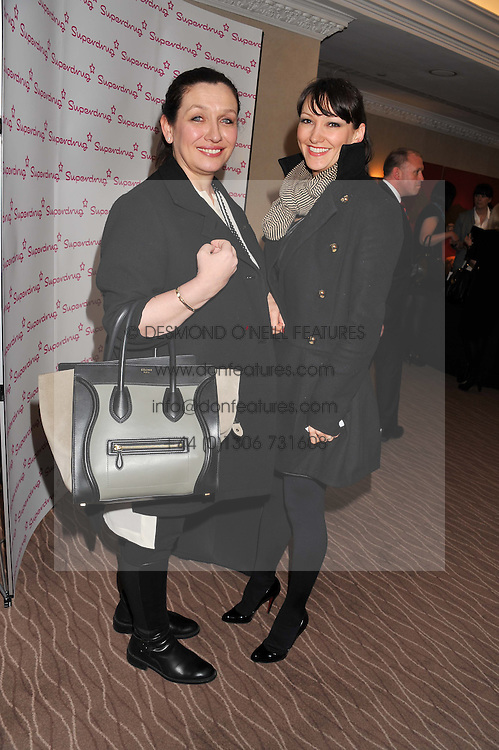 Left to right, DANIELA RINALDI director of perfumery and concessions at Harvey Nichols and HANNAH PHILLIPS Beauty buyer at Harvey Nichols at the Cosmetic Executive Women (CEW) UK Beauty Awards 2012 held at the Intercontinental Hotel, Hamilton Place, London on 27th March 2012.