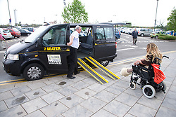 Young woman with Cerebral Palsy getting in to a taxi,