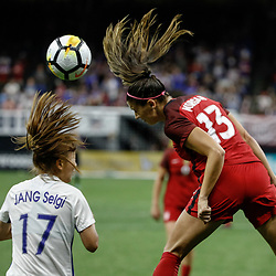 Oct 19, 2017; New Orleans, LA, USA; USA forward Alex Morgan (13) heads a ball past Korea Republic Jang Seulgi (17) during the second half of an International Friendly Women's Soccer match at the Mercedes-Benz Superdome. Mandatory Credit: Derick E. Hingle-USA TODAY Sports