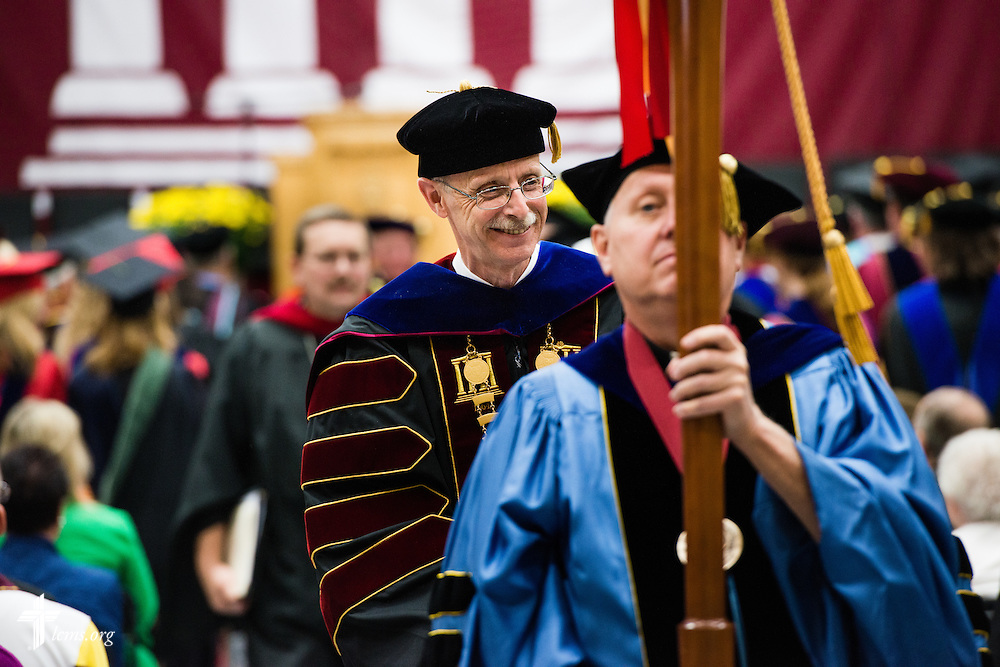 The Rev. Dr. Daniel Lee Gard, president of Concordia University Chicago, leaves his inauguration convocation at the college in River Forest, Ill., on Friday, Oct. 10, 2014. LCMS Communications/Erik M. Lunsford