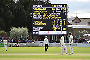 Ed Barnard of Worcestershire and Steve Magoffin of Worcestershire looking at the scoreboard and seeing the task at hand with one wicket remaining during the Specsavers County Champ Div 1 match between Somerset County Cricket Club and Worcestershire County Cricket Club at the Cooper Associates County Ground, Taunton, United Kingdom on 22 April 2018. Picture by Graham Hunt.