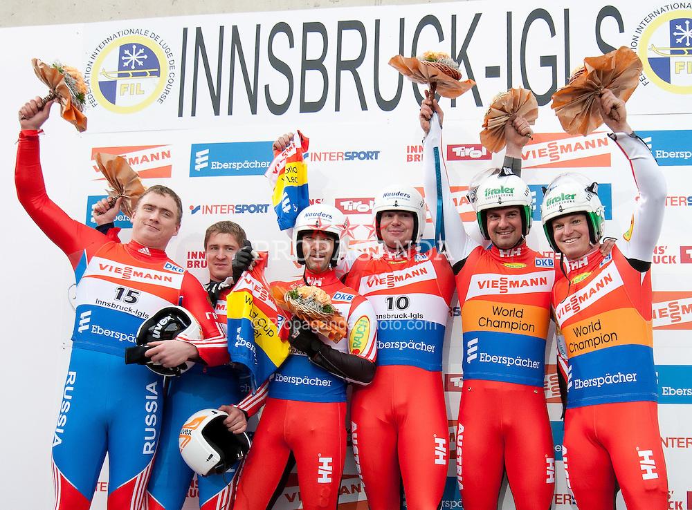 26.11.2011, Eiskanal, Igls, AUT, Viessmann Rennrodel Weltcup, Innsbruck, Herren Doppelsitzer Podium, im Bild v.l.n.r. 2. Platz  Vadislav Yuzhakov, Vladimir Makhnutin (RUS), 1 Platz Peter Penz, Georg Fischler (AUT) und 3. Platz Linger Andres, Linger Wolfgang (AUT) // f.l.t.r. second place Vadislav Yuzhakov, Vladimir Makhnutin of Russia, first place Peter Penz, Georg Fischler of Austria and third place Linger Andres, Linger Wolfgang of Austria on Podium after Men's double seater second run at Viessmann Luge World Cup at Olympic ice canal, Innsbruck Igls, Austria on 2011/11/26.EXPA Pictures © 2011, PhotoCredit: EXPA/ Johann Groder