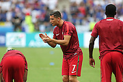 Portugal Forward Cristiano Ronaldo gives encouragement in warm up during the Euro 2016 final between Portugal and France at Stade de France, Saint-Denis, Paris, France on 10 July 2016. Photo by Phil Duncan.