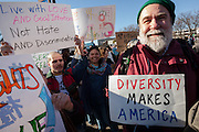 A man holds a sign saying Diversity Makes America at a protest march and rally organised by the Alliance for an Inclusive America group against the perceived anti-Muslim and anti-foreigner immigration policies of President Donald Trump, Shibuya, Tokyo, Japan. Sunday February 12th 2017. The Alliance of an Inclusive America is a multi-faith non-partisan group. About 250 Americans, other ex-pats and japanese people took part in the march to show people around the world they reject the Executive Order President Trump enacted at the end of January, indefinitely suspending the resettlement of Syrian refugees and temporarily banning people from seven majority Muslim countries from entering the United States.