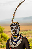 Kara tribe woman with chalk face painting, Omo Valley, Ethiopia.